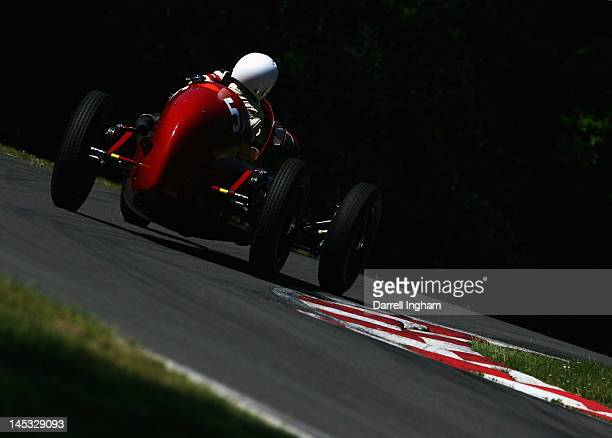 Josef Otto Rettenmaier of Germany drives the Maserati 6C34 during the Masters Historic Racing Festival Pre 66 Grand Prix cars race at the Brands...