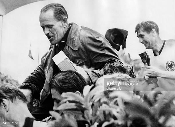 Josef 'Sepp' Herberger German football player and coach Football 1954 FIFA World Cup Final German football players carry their coach Herberger after...