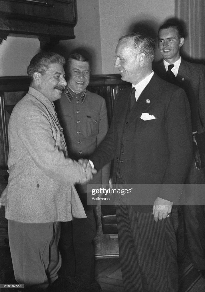 Josef Stalin, (L), Russian dictator and <a gi-track='captionPersonalityLinkClicked' href=/galleries/search?phrase=Joachim+Von+Ribbentrop&family=editorial&specificpeople=93593 ng-click='$event.stopPropagation()'>Joachim Von Ribbentrop</a>, German Foreign Minister, shake hands after signing the Soviet German Treaty of Friendship and agreeing on how Poland should be partitioned. Behind them can be seen the Russian Chief of Staff, Stapostnikov, and the Secretary of the German Embassy, Perlow. This picture passed British Censor and was rushed to New York via the Trans Atlantic Clipper.