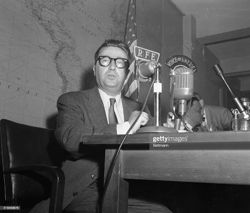 Josef Swiatlo who was deputy chief of Poland's secret police before he fled to the West is shown at a press conference at the Voice of America...