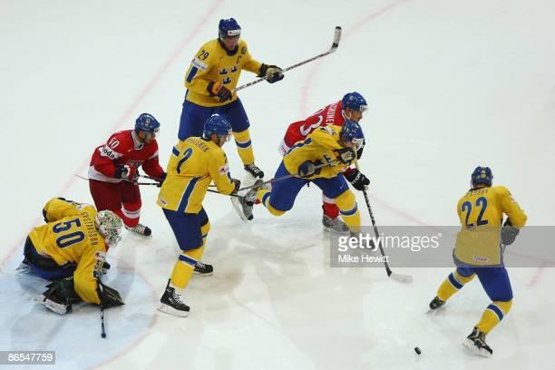 Josef Vasicek and Karel Rachunek of Czech Republic are outnumbered by Jonas Gustavsson Nicklas Grossman Kenny Johnsson Rikard Wallin and Niklas...