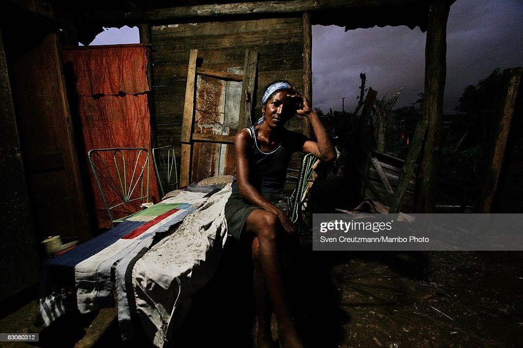 Josefa Ramon sits beside a makeshift bed consisting of four chairs and a door in what is left of her house destroyed as Hurricane Ike tore through a...