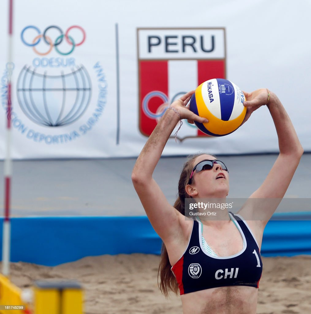Josefas Izquierdo Krogh of Chile spikes for the ball during the Women's Beach Volleyball Qualification as part of the I ODESUR South American Youth Games at Parque Tematico de los Deportes on September 24, 2013 in Lima, Peru.