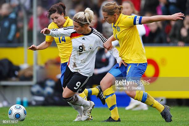 Josefin Johansson and Emma Wilhelmsson of Sweden tackle Svenja Huth of Germany during the Women's International friendly match between Germany U20...
