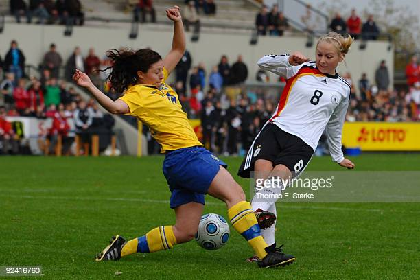 Josefin Johansson of Sweden and Kristina Gessat of Germany tackle for the ball during the women's international friendly match between Germany U20...