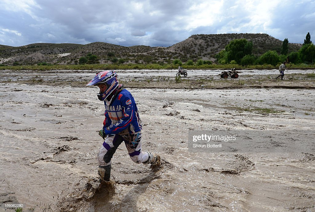 Josefina Gardulski of Team Team Yamaha Chile takes a break after the stage from Salta to Tucuman was interupted by a flash flood during the 2013 Dakar Rally on January 12, 2012 in Salta, Argentina.