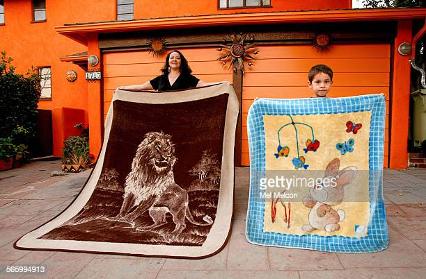 Josefina Lopez and her son Sebastien Deleage display their San Marcos blankets in front of their home in Los Angeles on February 9 2012 Josefina's...