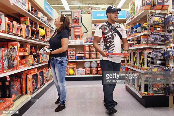 Josefina Ruiz and Javier Matos shop for toys at the Toys'R'Us store on September 28 2010 in Miami Florida Toys'R'Us announced today it will hire...