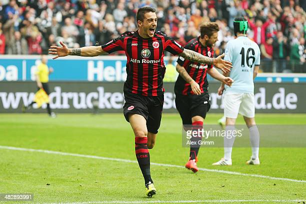 Joselu of Frankfurt celebrates his team's first goal during the Bundesliga match between Eintracht Frankfurt and 1 FSV Mainz 05 at Commerzbank Arena...