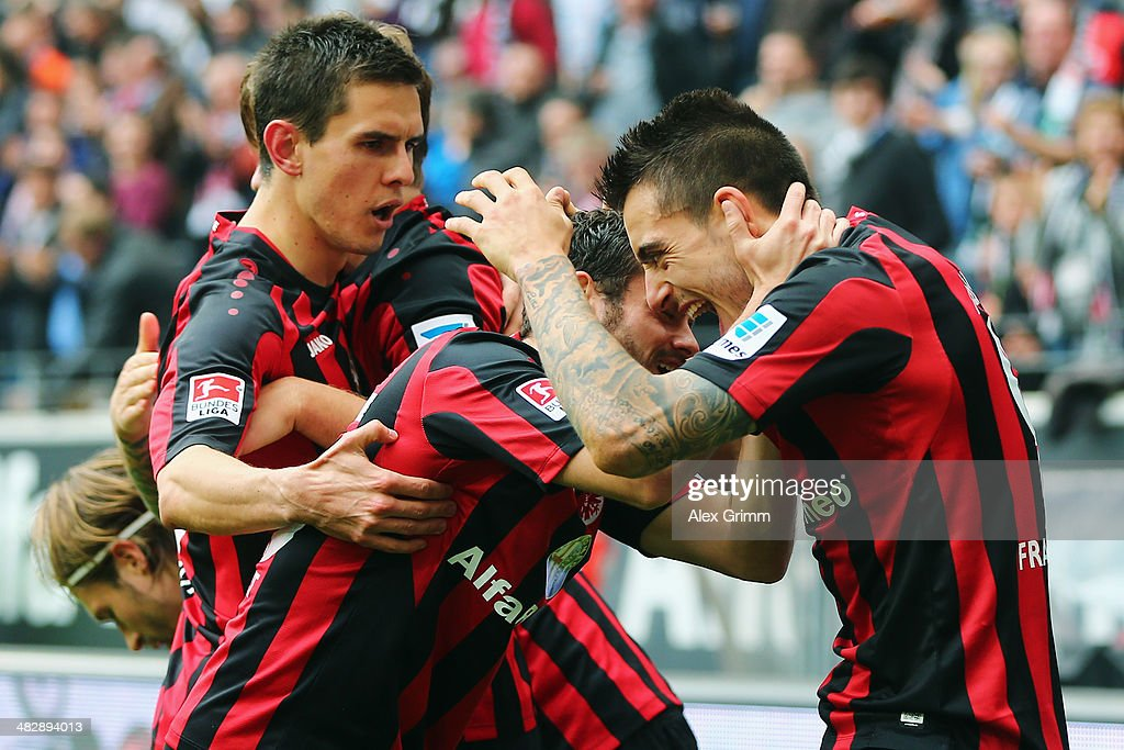 Joselu of Frankfurt celebrates his team's first goal with team mates <a gi-track='captionPersonalityLinkClicked' href=/galleries/search?phrase=Tranquillo+Barnetta&family=editorial&specificpeople=534444 ng-click='$event.stopPropagation()'>Tranquillo Barnetta</a> and <a gi-track='captionPersonalityLinkClicked' href=/galleries/search?phrase=Johannes+Flum&family=editorial&specificpeople=665021 ng-click='$event.stopPropagation()'>Johannes Flum</a> (R-L) during the Bundesliga match between Eintracht Frankfurt and 1. FSV Mainz 05 at Commerzbank Arena on April 5, 2014 in Frankfurt am Main, Germany.