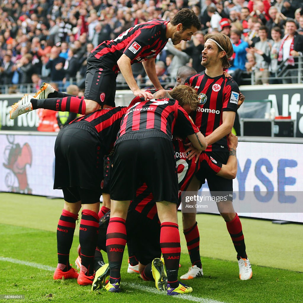 Joselu (C, hidden) of Frankfurt celebrates his team's first goal with team mates <a gi-track='captionPersonalityLinkClicked' href=/galleries/search?phrase=Tranquillo+Barnetta&family=editorial&specificpeople=534444 ng-click='$event.stopPropagation()'>Tranquillo Barnetta</a> (top) and <a gi-track='captionPersonalityLinkClicked' href=/galleries/search?phrase=Martin+Lanig&family=editorial&specificpeople=750456 ng-click='$event.stopPropagation()'>Martin Lanig</a> (R) during the Bundesliga match between Eintracht Frankfurt and 1. FSV Mainz 05 at Commerzbank Arena on April 5, 2014 in Frankfurt am Main, Germany.