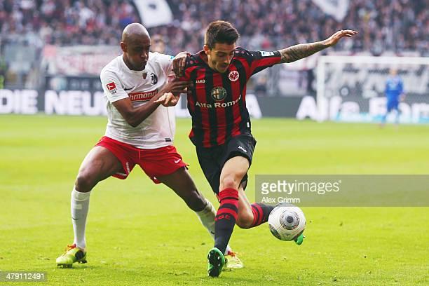 Joselu of Frankfurt is challenged by Gelson Fernandes of Freiburg during the Bundesliga match between Eintracht Frankfurt and SC Freiburg at...