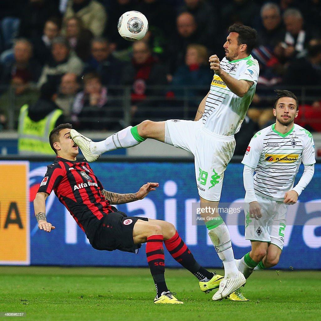 Joselu of Frankfurt is challenged by Martin Stranzl of Moenchengladbach during the Bundesliga match between Eintracht Frankfurt and Borussia...