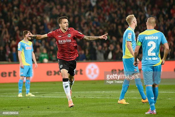 Joselu of Hannover celebrates scoring his goal during the Bundesliga match between Hannover 96 and 1 FC Koeln at HDIArena on September 24 2014 in...