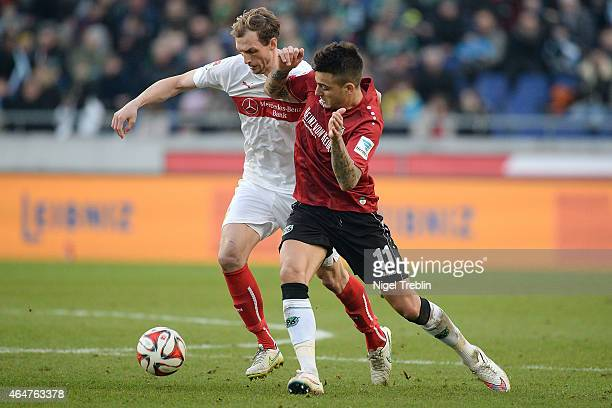 Joselu of Hannover is challenged by Georg Niedermeier of Stuttgart during to the Bundesliga match between Hannover 96 and VfB Stuttgart at HDIArena...