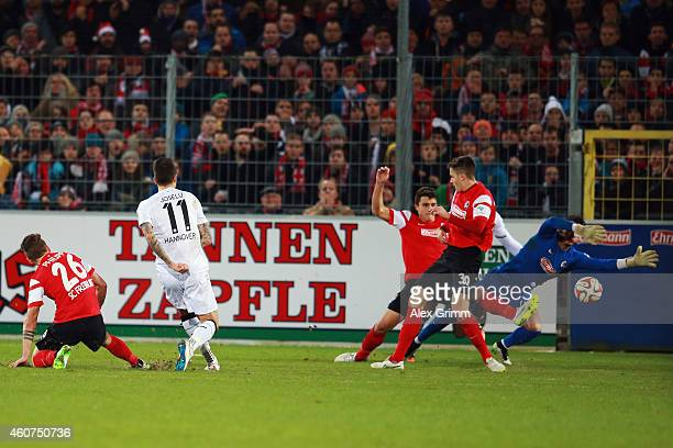 Joselu of Hannover scores his team's second goal during the Bundesliga match between SC Freiburg and Hannover 96 at SchwarzwaldStadion on December 21...