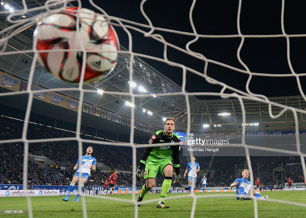 Joselu of Hannover scores his team's second goal past goalkeeper <a gi-track='captionPersonalityLinkClicked' href=/galleries/search?phrase=Oliver+Baumann&family=editorial&specificpeople=4645207 ng-click='$event.stopPropagation()'>Oliver Baumann</a> of Hoffenheim and <a gi-track='captionPersonalityLinkClicked' href=/galleries/search?phrase=Andreas+Beck&family=editorial&specificpeople=635198 ng-click='$event.stopPropagation()'>Andreas Beck</a> of Hoffenheim during the Bundesliga match between 1899 Hoffenheim and Hannover 96 at Wirsol Rhein-Neckar-Arena on November 29, 2014 in Sinsheim, Germany.
