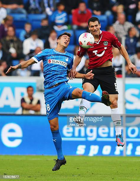 Joselu of Hoffenheim jumps for a header with Mario Eggimann of Hannover during the Bundesliga match between 1899 Hoffenheim and Hannover 96 at...