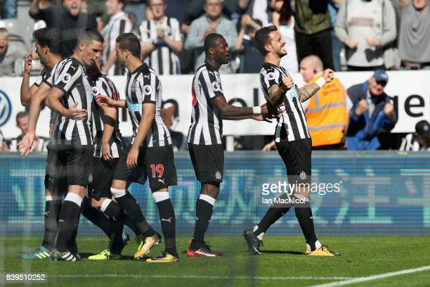 Joselu of Newcastle United celebrates scoring his sides first goal with his Newcastle United team mates during the Premier League match between...