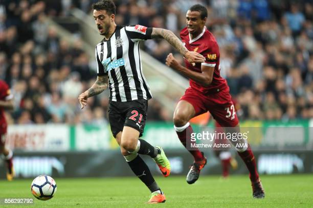 Joselu of Newcastle United competes with Joel Matip of Liverpool during the Premier League match between Newcastle United and Liverpool at St James'...