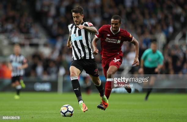 Joselu of Newcastle United evades Joel Matip of Liverpool to run on and score during the Premier League match between Newcastle United and Liverpool...