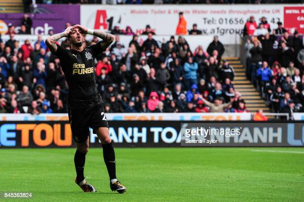 Joselu of Newcastle United holds his hands on his head as his attempt at goal is wide during the Barclays Premiership match between Swansea City and...