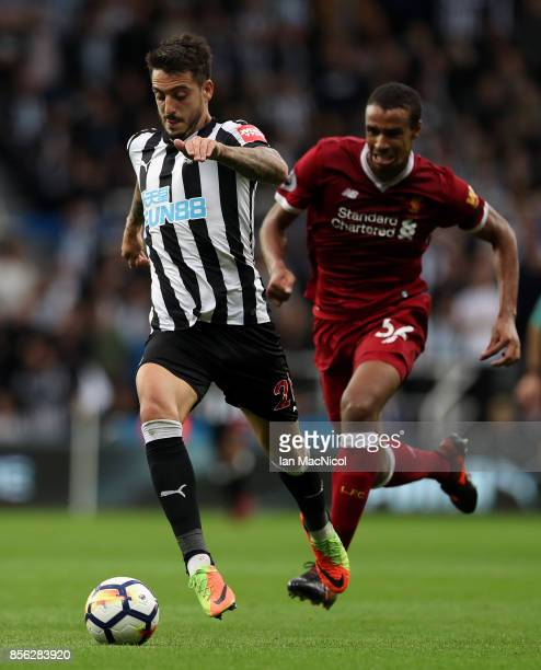 Joselu of Newcastle United is put under pressure from Joel Matip of Liverpool during the Premier League match between Newcastle United and Liverpool...