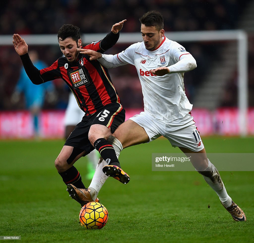 Joselu of Stoke City and Adam Smith of Bournemouth compete for the ball during the Barclays Premier League match between A.F.C. Bournemouth and Stoke City at Vitality Stadium on February 13, 2016 in Bournemouth, England.