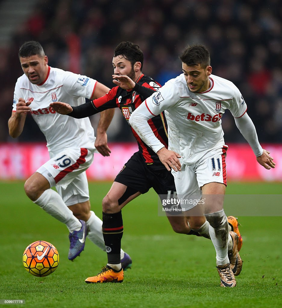 Joselu of Stoke City and <a gi-track='captionPersonalityLinkClicked' href=/galleries/search?phrase=Adam+Smith+-+Soccer+Right+Back&family=editorial&specificpeople=14054674 ng-click='$event.stopPropagation()'>Adam Smith</a> of Bournemouth compete for the ball during the Barclays Premier League match between A.F.C. Bournemouth and Stoke City at Vitality Stadium on February 13, 2016 in Bournemouth, England.