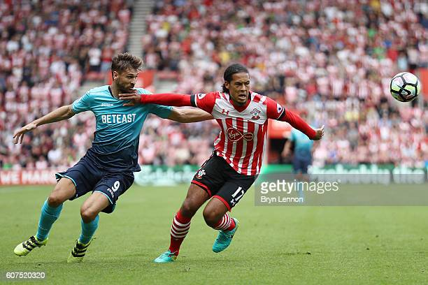 Joselu of Stoke City and Virgil van Dijk of Southampton battle for possession during the Premier League match between Southampton and Swansea City at...