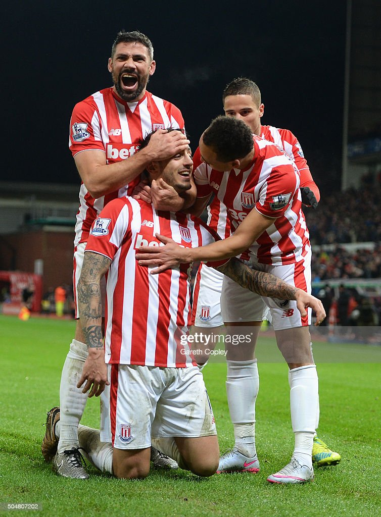 Joselu (2nd L) of Stoke City celebrates scoring his team's second goal with his team mates during the Barclays Premier League match between Stoke City and Norwich City at the Britannia Stadium on January 13, 2016 in Stoke on Trent, England.