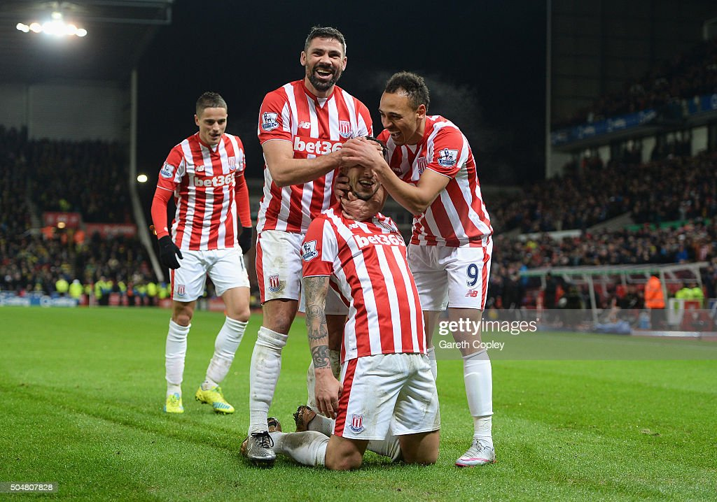 Joselu (2nd R) of Stoke City celebrates scoring his team's second goal with his team mates <a gi-track='captionPersonalityLinkClicked' href=/galleries/search?phrase=Ibrahim+Afellay&family=editorial&specificpeople=837737 ng-click='$event.stopPropagation()'>Ibrahim Afellay</a> (1st L), <a gi-track='captionPersonalityLinkClicked' href=/galleries/search?phrase=Jonathan+Walters&family=editorial&specificpeople=3389578 ng-click='$event.stopPropagation()'>Jonathan Walters</a> (2nd L) and <a gi-track='captionPersonalityLinkClicked' href=/galleries/search?phrase=Peter+Odemwingie&family=editorial&specificpeople=648594 ng-click='$event.stopPropagation()'>Peter Odemwingie</a> (1st R) of Stoke City during the Barclays Premier League match between Stoke City and Norwich City at the Britannia Stadium on January 13, 2016 in Stoke on Trent, England.