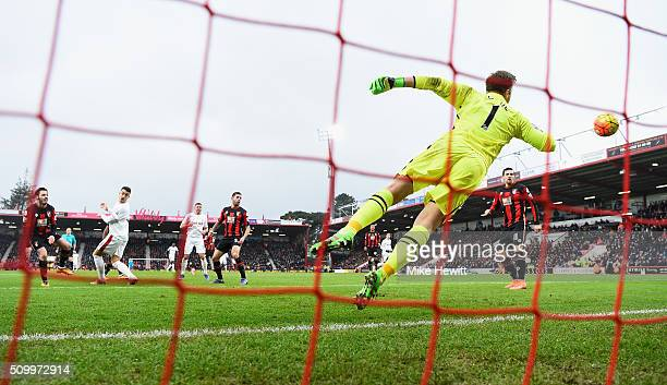 Joselu of Stoke City heads the ball to score his team's third goal past Artur Boruc of Bournemouth during the Barclays Premier League match between...