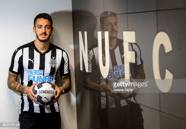 Joselu poses for photographs in the dressing room at StJames' Park on August 15 in Newcastle upon Tyne England