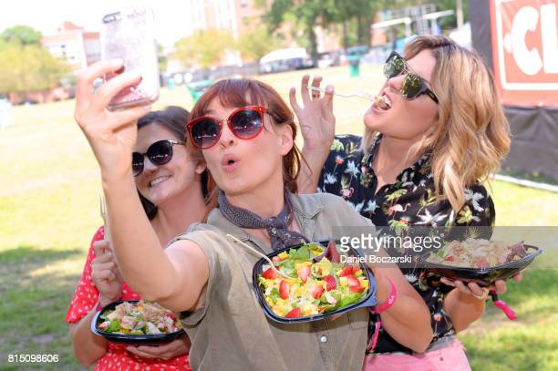 Joselyn Hughes Mamrie Hart and Grace Helbig freshen up at Wendy's ReFresh Tent during Pitchfork Music Festival on July 15 2017 in Chicago Illinois