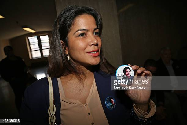 Joselyn Martinez the daughter of Jose Martinez holds a button with her father's image in Manhattan Supreme Court Jose was murdered by Justo Santos in...