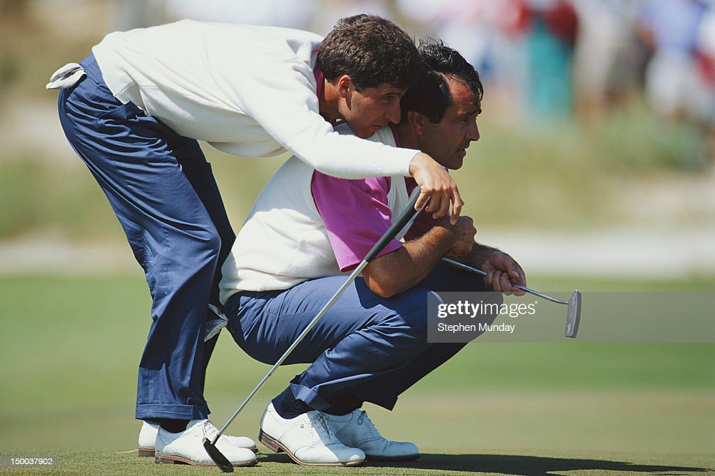 JoseMaria Olazabal of Spain uses the shoulders of Seve Ballesteros also of Spain to get a better view of the hole during the 29th Ryder Cup Matches...