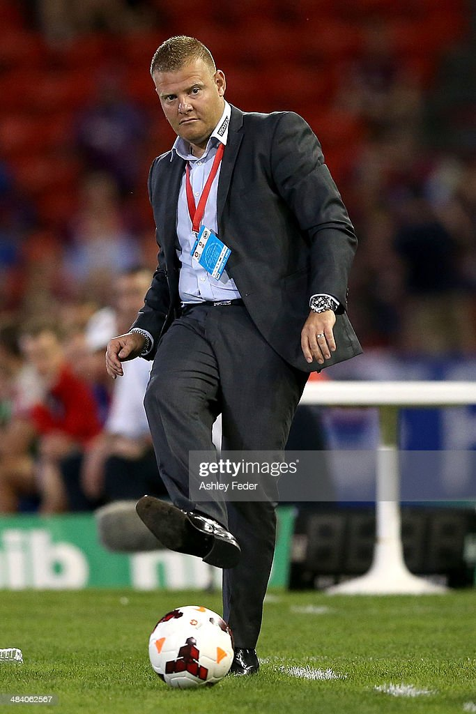 Josep Gombau coach of Adelaide United kicks the ball during the round 27 A-League match between the Newcastle Jets and Adelaide United at Hunter Stadium on April 11, 2014 in Newcastle, Australia.