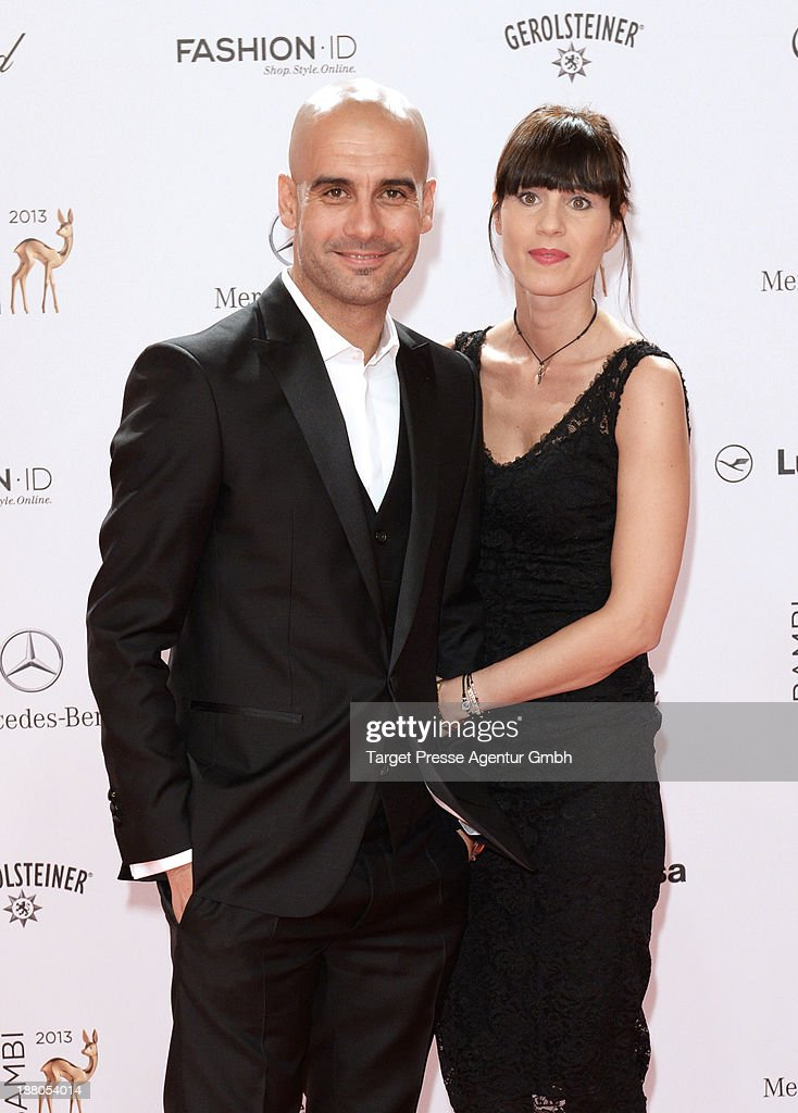 <a gi-track='captionPersonalityLinkClicked' href=/galleries/search?phrase=Josep+Guardiola&family=editorial&specificpeople=2088964 ng-click='$event.stopPropagation()'>Josep Guardiola</a> and his wife Cristina Serra attend the Bambi Award 2013 at Stage Theater on November 14, 2013 in Berlin, Germany.