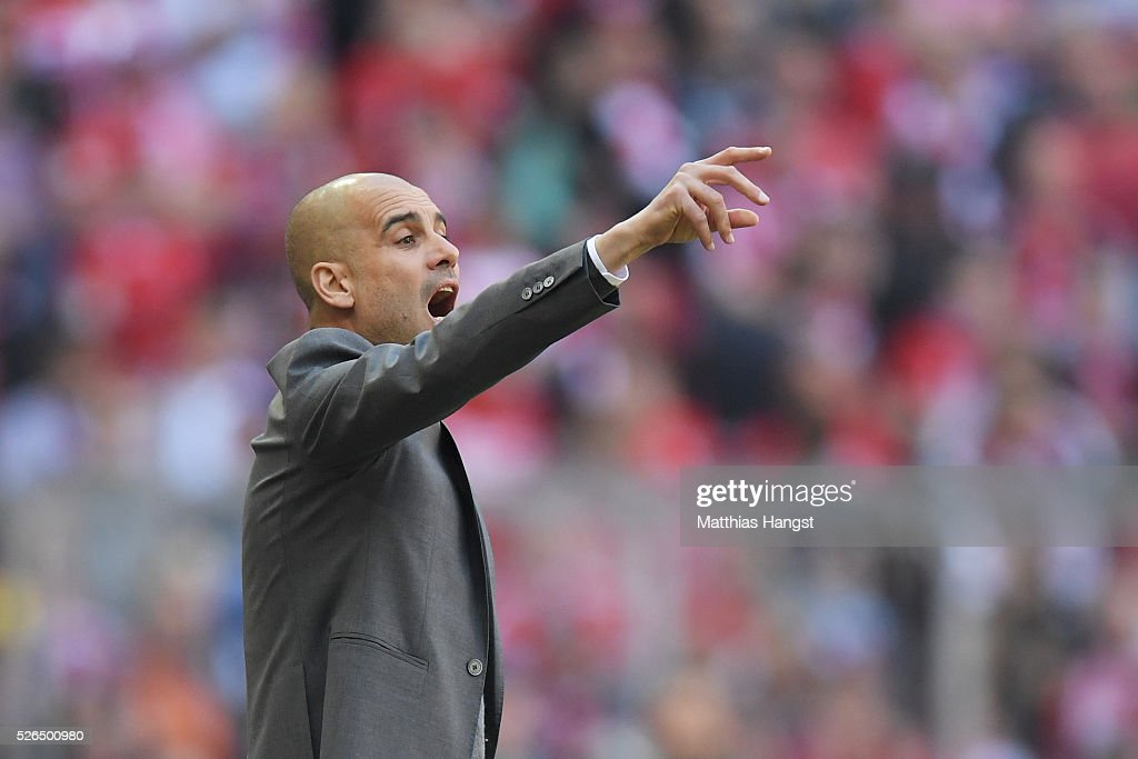 Josep Guardiola, coach of Bayern Muenchen gestures during the Bundesliga match between Bayern Muenchen and Borussia Moenchengladbach at Allianz Arena on April 30, 2016 in Munich, Germany.