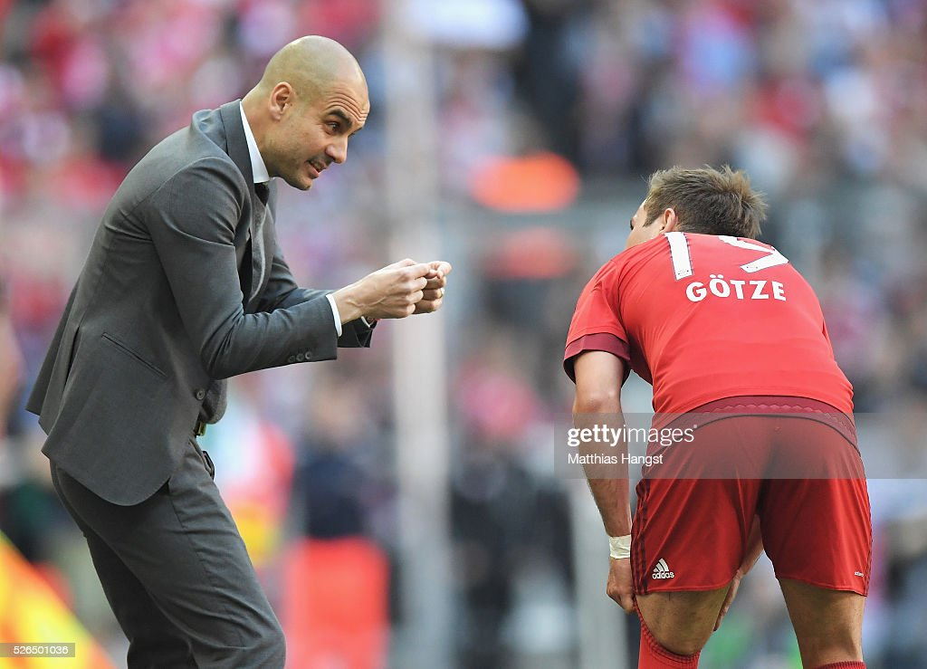 Josep Guardiola (L), coach of Bayern Muenchen instructs to his player Mario Goetze (R) during the Bundesliga match between Bayern Muenchen and Borussia Moenchengladbach at Allianz Arena on April 30, 2016 in Munich, Germany.