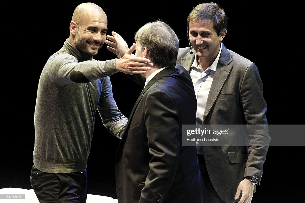 Josep Guardiola coach of Bayern Munchen and former coach of Barcelona (L) greets Gerardo Martino former coach of Barcelona (M) during the conference titled 'El Mundial segun Pep' conducted by sports journalist Juan Pablo Varsky (L) at Luna Park Stadium on June 26, 2014 in Buenos Aires, Argentina.