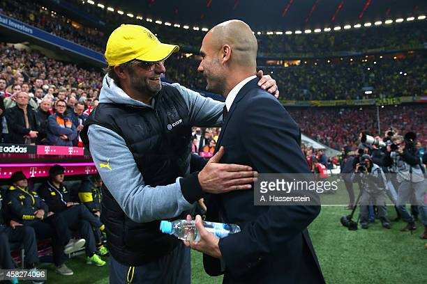 Josep Guardiola head choach of Muenchen shake hands with Juergen Klopp head coach of Dortmund prior to the Bundesliga match between FC Bayern...
