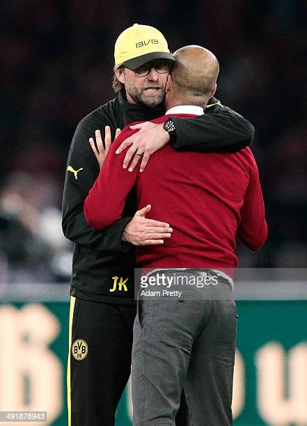 Josep Guardiola Head Coach of Bayern is congratulated by Juergen Klopp Head Coach of Borussia Dortmund after winning the DFB Cup Final match in...