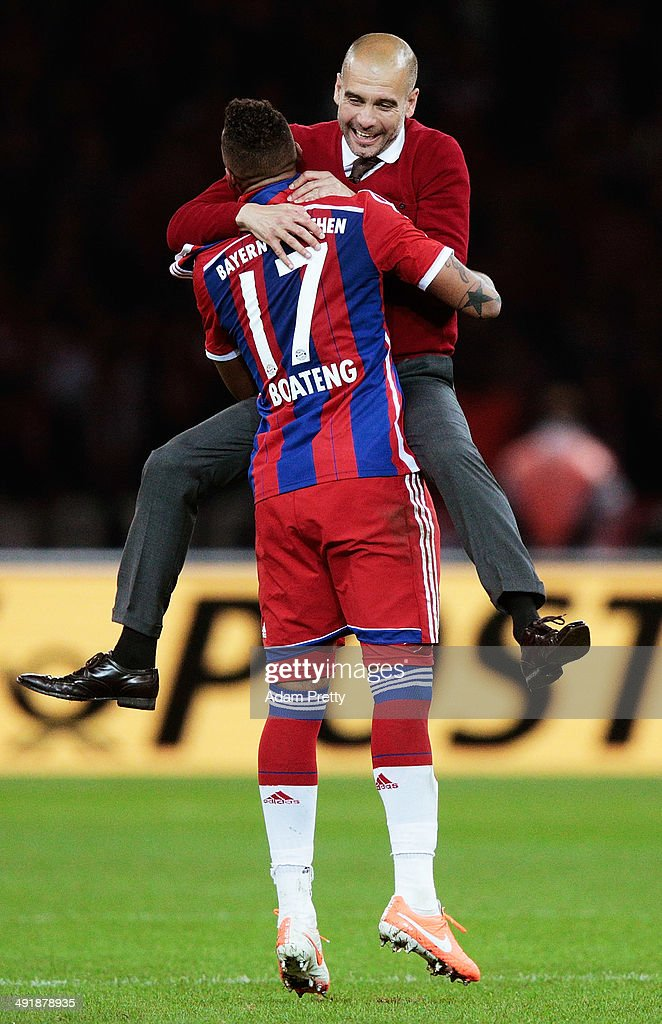 <a gi-track='captionPersonalityLinkClicked' href=/galleries/search?phrase=Josep+Guardiola&family=editorial&specificpeople=2088964 ng-click='$event.stopPropagation()'>Josep Guardiola</a> Head Coach of Bayern Muenchen celebrates with Jermone Boateng after winning the DFB Cup Final match in between Borussia Dortmund and FC Bayern Muenchen at Olympiastadion on May 17, 2014 in Berlin, Germany.