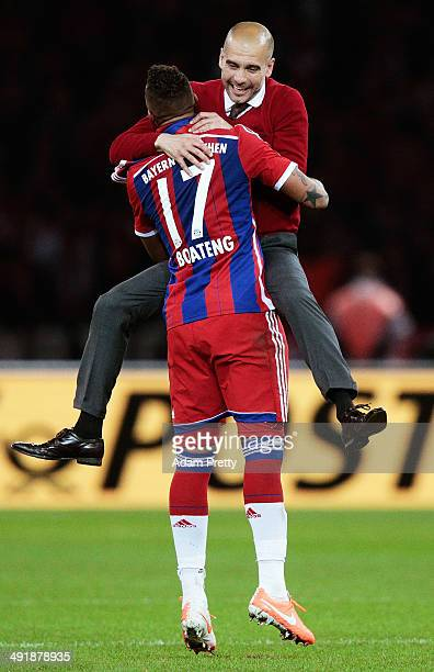 Josep Guardiola Head Coach of Bayern Muenchen celebrates with Jermone Boateng after winning the DFB Cup Final match in between Borussia Dortmund and...