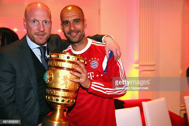 Josep Guardiola head coach of Bayern Muenchen holds the German DFB Cup Trophy with his sporting director Matthias Sammer during the FC Bayern...