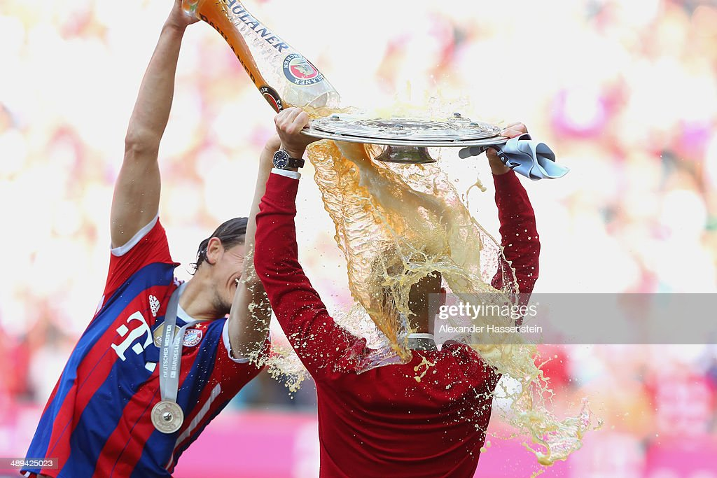 <a gi-track='captionPersonalityLinkClicked' href=/galleries/search?phrase=Josep+Guardiola&family=editorial&specificpeople=2088964 ng-click='$event.stopPropagation()'>Josep Guardiola</a> head coach of Bayern Muenchen is showered with beer by Daniel Van Buyten as he celebrates with the Bundesliga championship trophy after the Bundesliga match between Bayern Muenchen and VfB Stuttgart at Allianz Arena on May 10, 2014 in Munich, Germany.