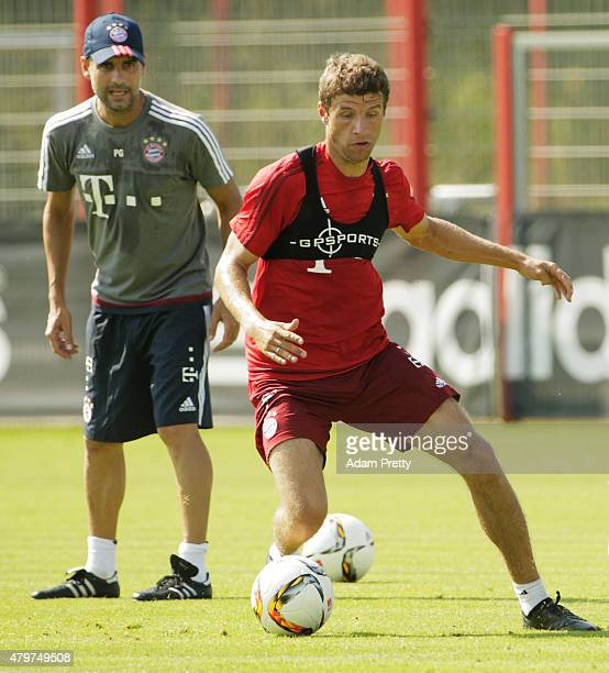 Josep Guardiola Head Coach of Bayern Muenchen keeps a close eye on Thomas Mueller of Bayern Muenchen during the FC Bayern Muenchen Training Session...