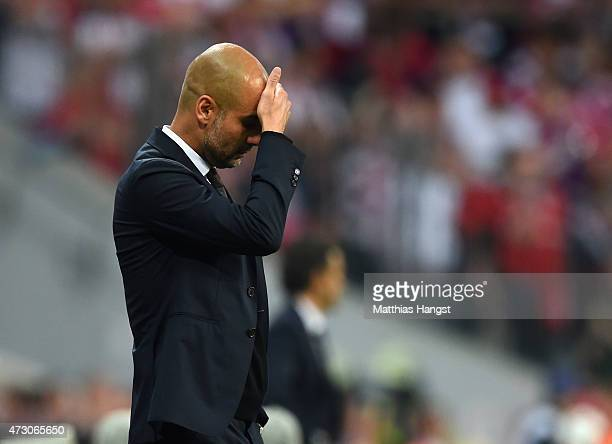 Josep Guardiola head coach of Bayern Muenchen looks dejected during the UEFA Champions League semi final second leg match between FC Bayern Muenchen...